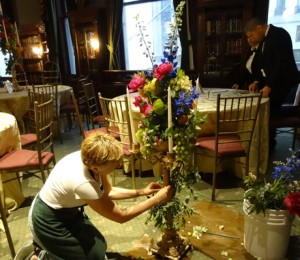 arranging candelabra for party